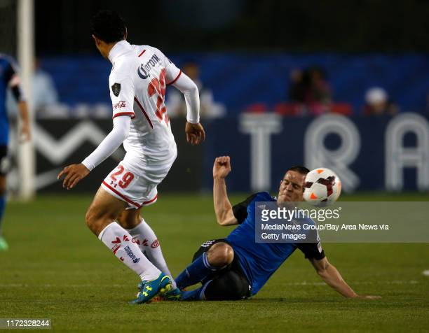 San Jose Earthquakes' Sam Cronin fights for the ball against Deportivo Toluca FC's Ra√∫l Nava in the first half at Buck Shaw Stadium in Santa Clara...