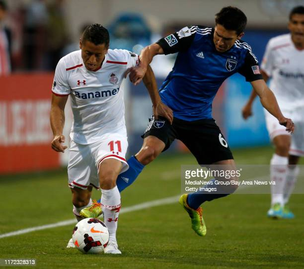 San Jose Earthquakes' Shea Salinas fights for the ball against Deportivo Toluca FC's Carlos Esquivel in the first half at Buck Shaw Stadium in Santa...