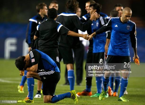 San Jose Earthquakes' Shea Salinas kneels as the San Jose Earthquakes celebrate following their 11 tie against Deportivo Toluca FC at Buck Shaw...