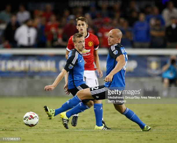 San Jose Earthquakes' Tommy Thompson and Mark Sherrod battle for the ball against Manchester United's Adnan Januzaj in the second half of the...