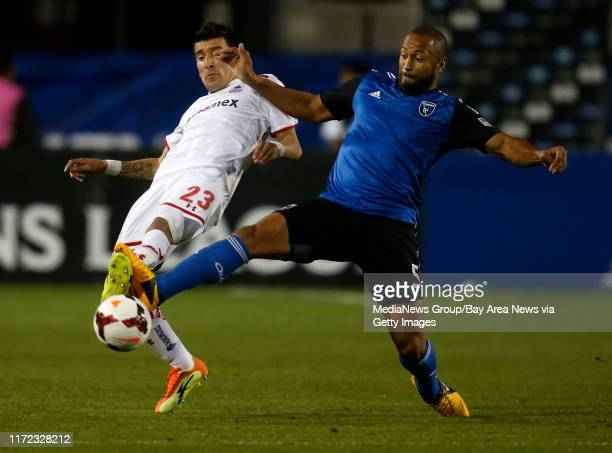 San Jose Earthquakes' Victor Bernardez fights for the ball against Deportivo Toluca FC's Edgar Benítez in the second half at Buck Shaw Stadium in...