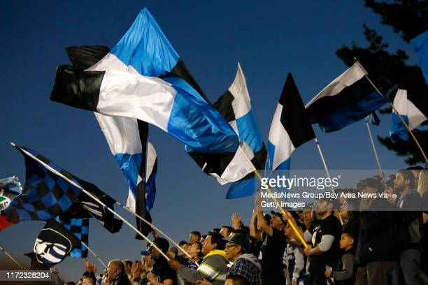 San Jose Earthquakes wave their flags and chant for the Earthquakes during their game against Deportivo Toluca FC in the first half at Buck Shaw...