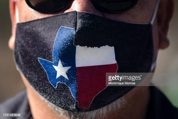 San Jose Hotel engineering manager Rocky Ontiveros wears a Texas mask on March 3, 2021 in Austin, Texas. Gov. Greg Abbott announced a new executive...