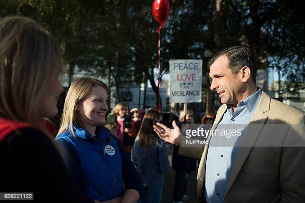 San Jose Mayor Sam Liccardo talks to Mary Clare Bernal one of the organizers of a quotLove Trumps Hatequot march in downtown San Jose on November 27...