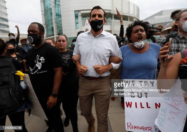 San Jose Mayor Sam Liccardo walks with protesters during a protest of the killing of George Floyd outside of San Jose City Hall in downtown San Jose...