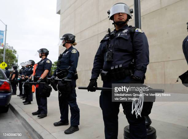 San Jose Police officers stand guard outside of San Jose City Hall during a protest for George Floyd in downtown San Jose Calif on Sunday May 31 2020