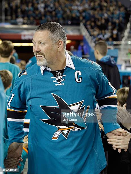 San Jose Sharks alumni Owen Nolan walks on to the field before the 2015 Coors Light NHL Stadium Series game between the Los Angeles Kings and the San...