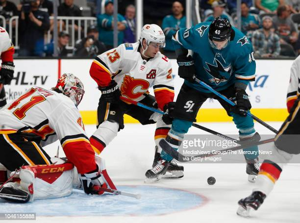 San Jose Sharks' Antti Suomela looks for the puck against Calgary Flames' Sean Monahan in the first period at the SAP Center in San Jose Calif on...