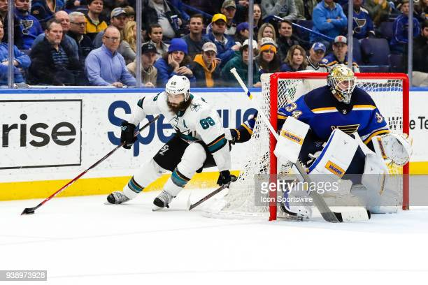 San Jose Sharks' Brent Burns left makes a move behind St Louis Blues goaltender Jake Allen during the overtime period of an NHL hockey game The St...