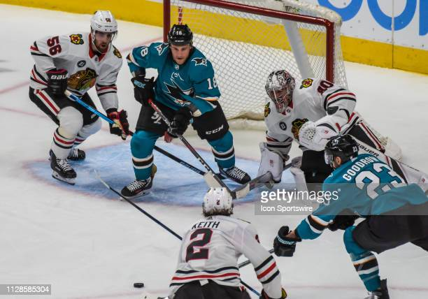 San Jose Sharks Center Barclay Goodrow comes in to play the puck with teammate San Jose Sharks Left Wing Micheal Haley in front of the net between...