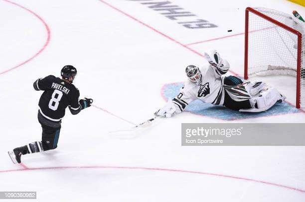 San Jose Sharks center Joe Pavelski has his shot saved by Minnesota Wild goaltender Devan Dubnyk during the NHL All-Star Game at SAP Center on...
