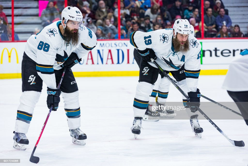San Jose Sharks Center Joe Thornton (19) along side San Jose Sharks Defenceman Brent Burns (88) prepare for the face-off during first period National Hockey League action between the San Jose Sharks and Ottawa Senators on January 5, 2018, at Canadian Tire Centre in Ottawa, ON, Canada.