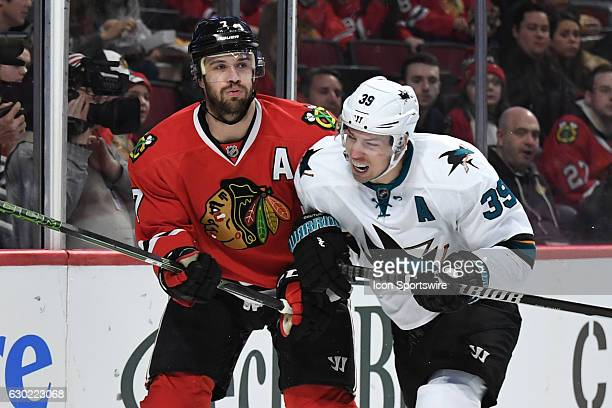San Jose Sharks center Logan Couture checks Chicago Blackhawks defenseman Brent Seabrook in the second period during a game between the San Jose...