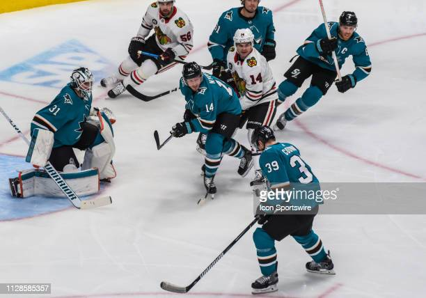San Jose Sharks Center Logan Couture gets a close pass from San Jose Sharks Left Wing Gustav Nyquist during the game between the Chicago Blackhawks...