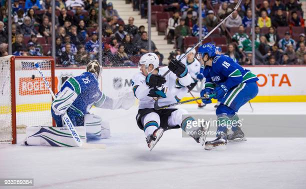San Jose Sharks Center Logan Couture scores on Vancouver Canucks Goalie Jacob Markstrom as Vancouver Canucks Right Wing Jake Virtanen looks on during...