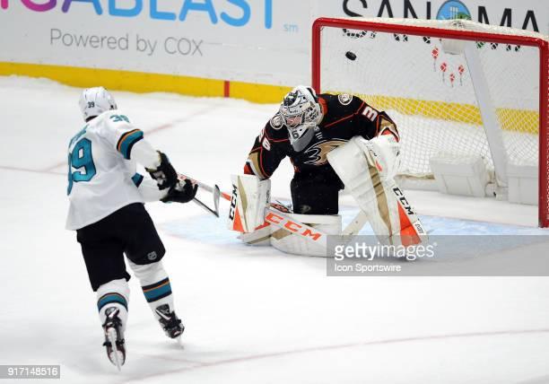 San Jose Sharks center Logan Couture scores the game winning goal past Anaheim Ducks goalie John Gibson during an overtime shootout in a game played...