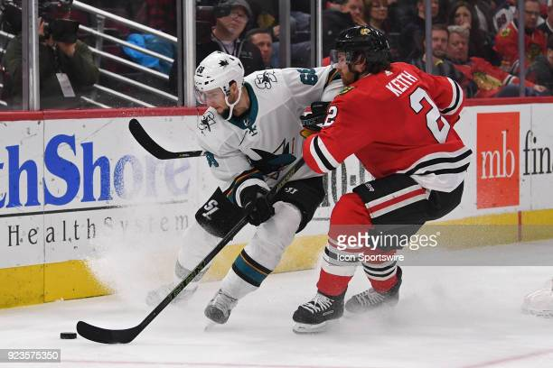 San Jose Sharks center Melker Karlsson controls the puck against Chicago Blackhawks defenseman Duncan Keith in the second period during a game...