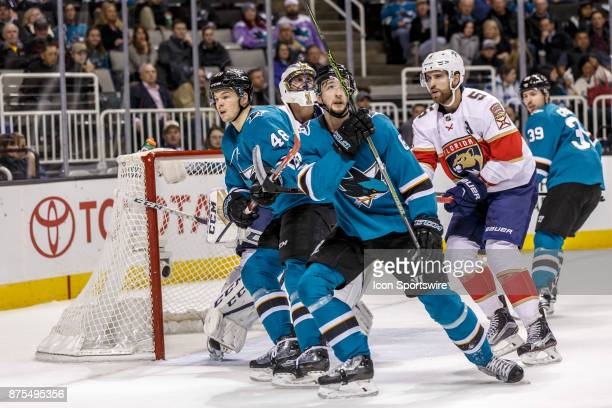 San Jose Sharks crowd the front of the Florida Panthers net looking for a centering pass during the first period of the regular season game between...