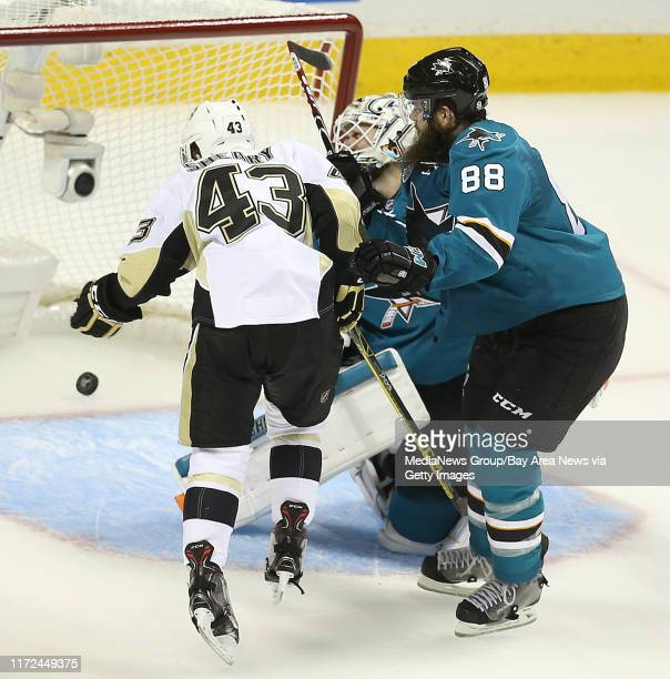 San Jose Sharks defenseman Brent Burns defends Pittsburgh Penguins forward Conor Sheary as teammate Patric Hornqvist scores on goaltender Martin...