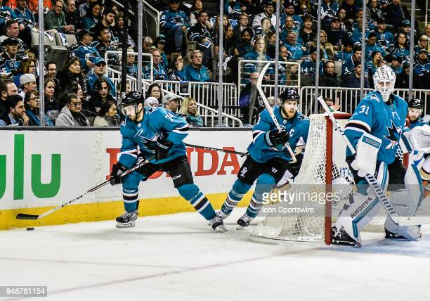 San Jose Sharks defenseman Dylan DeMelo and San Jose Sharks center Joe Pavelski move the puck around the back of the Sharks goal during the Stanley...