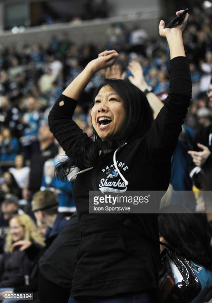 San Jose Sharks fan cheers after the Sharks score a goal in the first period of a NHL hockey game between the Nashville Predators and the San Jose...