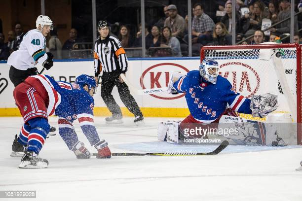 San Jose Sharks Forward Antti Suomela watches the puck go in the net behind New York Rangers Goaltender Henrik Lundqvist as Defenseman Adam McQuaid...