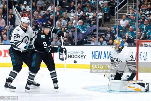 San Jose Sharks forward Joe Pavelski deflects a pass towards Nashville Predators goalie Pekka Rinne at the NHL AllStar Game on January 26 at SAP...