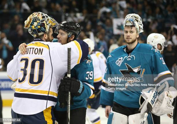 San Jose Sharks forward Logan Couture gets a hug from Nashville Predators goaltender Carter Hutton after the Sharks 50 win in Game 7 of the second...