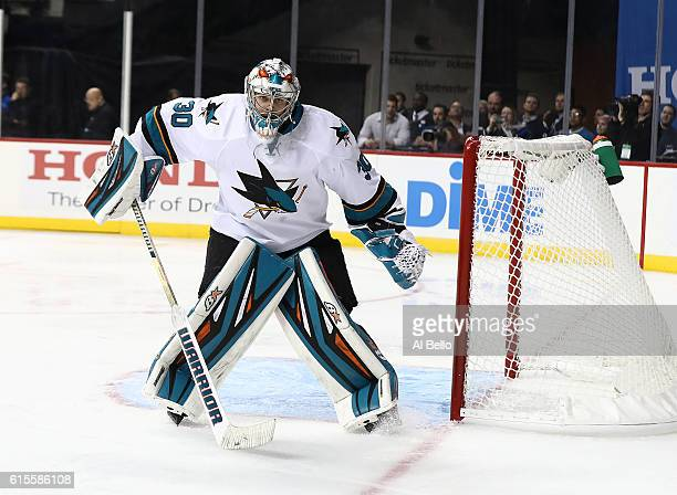 San Jose Sharks goalie Aaron Dell in action against the New York Islanders during their game at the Barclays Center on October 18 2016 in New York...