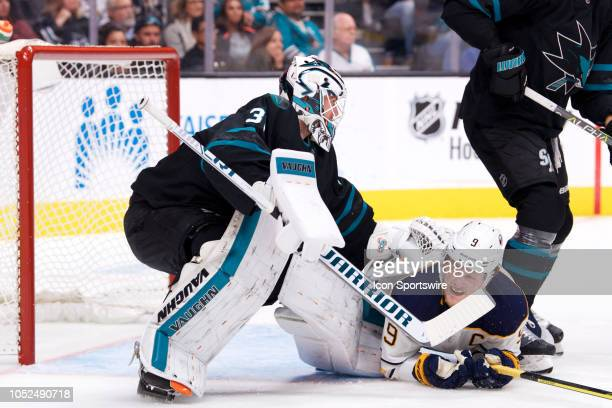 San Jose Sharks goaltender Martin Jones knocks down Buffalo Sabres center Jack Eichel during the San Jose Sharks game versus the Buffalo Sabres on...