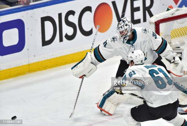 San Jose Sharks goaltender Martin Jones knocks the puck away in the first period during game six of the NHL Western Conference Final between the San...