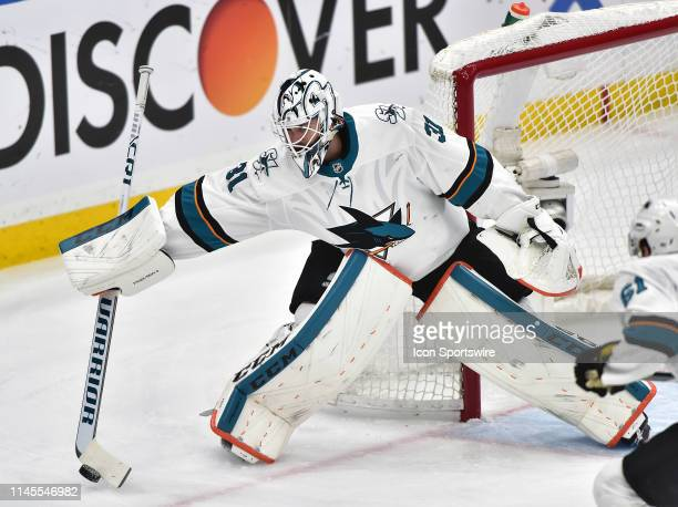 San Jose Sharks goaltender Martin Jones knocks the puck away with his stick during game six of the NHL Western Conference Final between the San Jose...