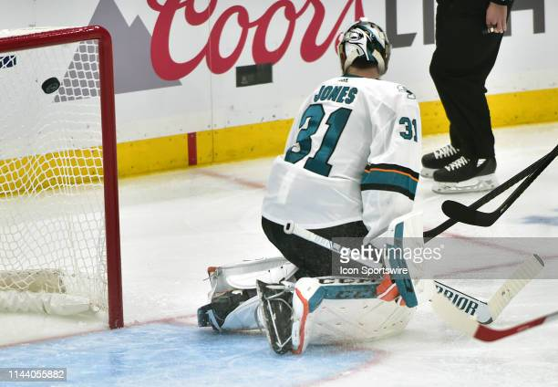 San Jose Sharks goaltender Martin Jones looks back as the Blues score in the second period during a NHL Stanley Cup Playoffs Western Conference Final...