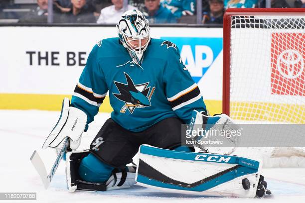 San Jose Sharks goaltender Martin Jones makes a save during the San Jose Sharks game versus the Edmonton Oilers on November 12 at SAP Center at San...