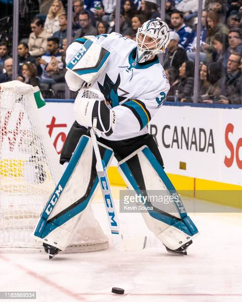 San Jose Sharks goaltender Martin Jones plays the puck against the Toronto Maple Leafs during the first period at the Scotiabank Arena on October 25...