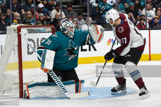 San Jose Sharks goaltender Martin Jones saves a shot from Colorado Avalanche forward Tyson Jost during game seven of the second round of the Stanley...