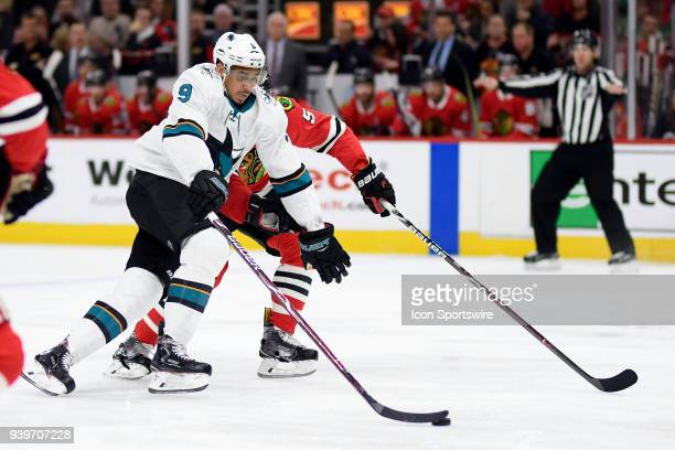 San Jose Sharks left wing Evander Kane battles with Chicago Blackhawks defenseman Connor Murphy in action during a game between the Chicago...