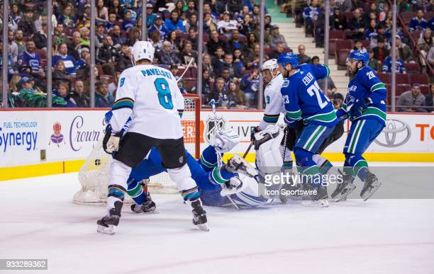 San Jose Sharks Left Wing Evander Kane battles with Vancouver Canucks defenseman Alexander Edler as San Jose Sharks Right Wing Kevin Labanc scores on...