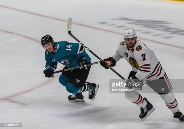 San Jose Sharks Left Wing Gustav Nyquist races behind Chicago Blackhawks Defenceman Brent Seabrook down the ice during the game between the Chicago...