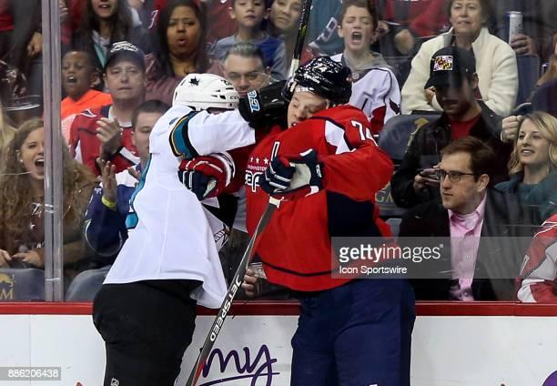 San Jose Sharks left wing Marcus Sorensen smashes into Washington Capitals defenseman John Carlson during a NHL game between the Washington Capitals...