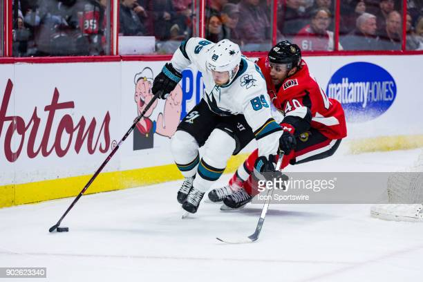 San Jose Sharks Left Wing Mikkel Boedker attempts to escape the reach of Ottawa Senators Right Wing Gabriel Dumont during first period National...