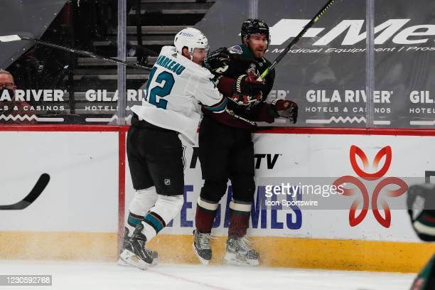 San Jose Sharks left wing Patrick Marleau checks Arizona Coyotes defenseman Jordan Oesterle during the NHL hockey game between the San Jose Sharks...