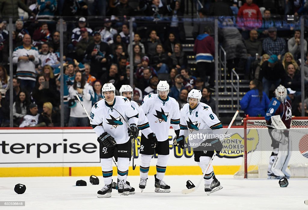 San Jose Sharks left wing Patrick Marleau (12) front, skates past ball caps thrown on the ice after his hat trick during the third period January 23, 2017 at Pepsi Center. The San Jose Sharks defeated the Colorado Avalanche 5-2.
