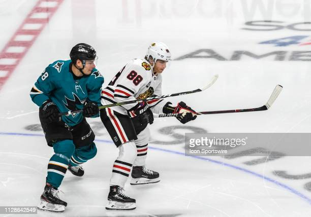 San Jose Sharks Left Wing Timo Meier and Chicago Blackhawks Right Wing Patrick Kane race into play during the game between the Chicago Blackhawks and...