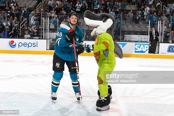 San Jose Sharks mascot SJ Sharkie dresses up as a teenage mutant ninja turtle and celebrates with Tomas Hertl after the game against the St Louis...