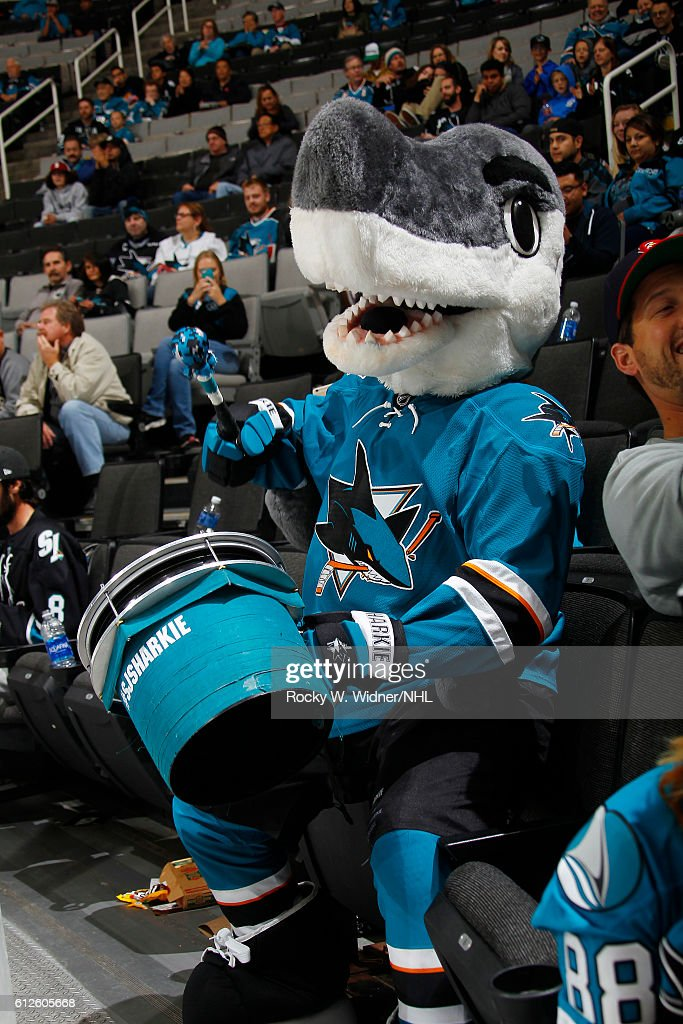 San Jose Sharks mascot S.J. Sharkie sits alongside fans during the game against the Arizona Coyotes at SAP Center on September 30, 2016 in San Jose, California.