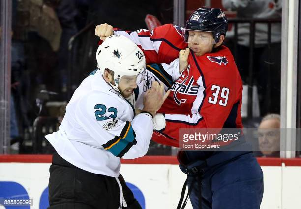 San Jose Sharks right wing Barclay Goodrow and Washington Capitals right wing Alex Chiasson battles in the last minutes of the game during a NHL game...