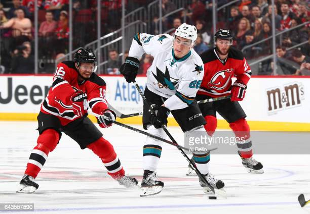 San Jose Sharks right wing Timo Meier skates against New Jersey Devils center Jacob Josefson during their game at the Prudential Center on February...