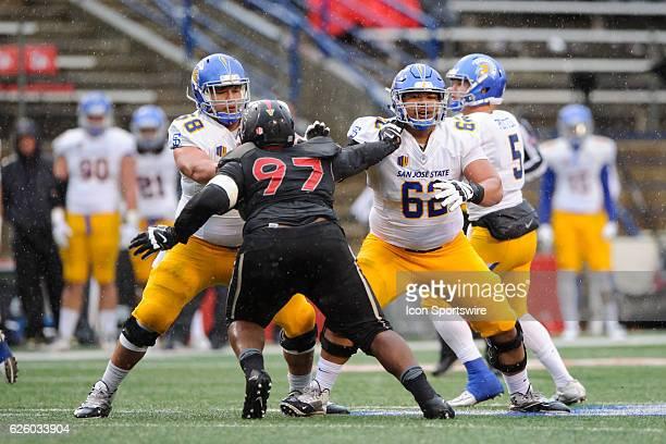 San Jose State Spartans center Keoni Taylor and San Jose State Spartans guard Jeremiah Kolone block Fresno State Bulldogs defensive lineman Malik...