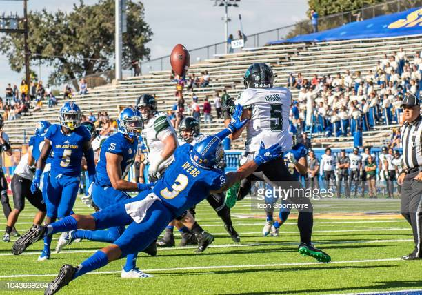 San Jose State Spartans cornerback Tre Webb pushes Hawaii Warriors wide receiver John Ursua away from a pass near the goal line during the game...